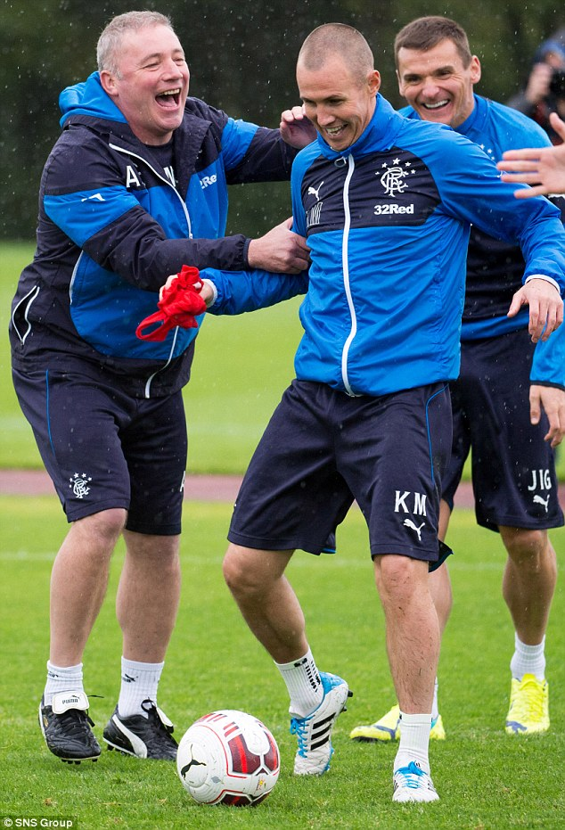 Off-field distractions: Rangers manager Ally McCoist (left) attempts to focus on the playing side of the club