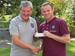 HERTFORD, ENGLAND - SEPTEMBER 02:  (EDITORS NOTE:  IMAGES STRICTLY EMBARGOED FROM ALL USAGE UNTIL 22:30 BST ON TUESDAY SEPTEMBER 2, 2014) (EXCLUSIVE COVERAGE)  England manager Roy Hodgson presents Wayne Rooney with a captain's armband during the England press conference at The Grove Hotel on September 2, 2014 in Hertford, United Kingdom.  (Photo by Michael Regan - The FA/The FA via Getty Images)