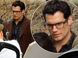 """EXCLUSIVE: Henry Cavill seen as Clark Kent on the set of """"Batman v Superman"""" in Detroit. Henry Cavill is seen coming out of the building being used as the Gotham City Jail.  Pictured: Henry Cavill Ref: SPL832608  020914   EXCLUSIVE Picture by: Bananadoc/Splash News  Splash News and Pictures Los Angeles: 310-821-2666 New York: 212-619-2666 London: 870-934-2666 photodesk@splashnews.com"""