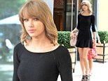Putting in the leg work! Taylor Swift displays her slender pins in form-fitting black minidress after jetting into UK on private jet
