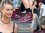 The couple who coordinates... Behati Prinsloo and her husband Adam Levine sported matching burgundy Dr. Martens boots as they shopped around New York's Soho neighbourhood on Tuesday