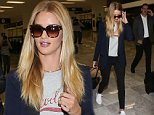 MEXICO CITY, MEXICO - SEPTEMBER 03:  Rosie Huntington-Whiteley arrives in Mexico City on September 3, 2014 in Mexico City, Mexico.  (Photo by Victor Chavez/GC Images)