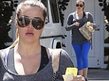 Khloe Kardashian puts her pouty lips and shapely figure on display as she heads to the gym for gut-busting workout