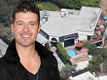 'Drunk' Robin Thicke gets ticket from police for playing loud music at his Hollywood mansion