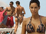 Beach babe: Nicole Murphy hit the beach in Miami with her hunky business partner on Monday, taking time off from promoting her wine, Destiny Moscato
