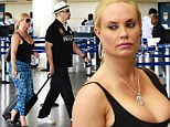 A LITTLE more demure! Coco Austin ditches G-string bikini for patterned blue leggings as she jets home from Barbados with husband Ice-T