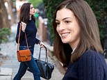 Professional: Anne Hathaway looked preppy in a navy cable-knit sweater and skinny jeans as she filmed The Intern in New York City Monday