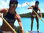 Great guns! Incredibly ripped and bikini-clad Sharni Vinson reveals her very muscular arms as she goes paddle boarding in Hawaii