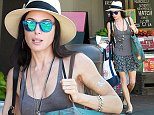 """Defiance"" Star Jaime Murray wearing fedora ,skirt and blue sunglasses spotted recycling at an L.A store.  Pictured: Jaime Murray. Ref: SPL832886  020914   Picture by: JLM / Splash News  Splash News and Pictures Los Angeles: 310-821-2666 New York: 212-619-2666 London: 870-934-2666 photodesk@splashnews.com"