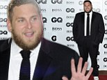 Living large in London! Jonah Hill shows off his bigger build as he scoops GQ International Man Of The Year award