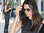Kendall Jenner shows off slim physique in skinny jeans and crop top as she pounds New York streets with model portfolio for second day running