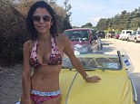 No-one's looking at the car! Bethenny Frankel displays her incredibly slim and toned bikini body as she perches on a classic Ferrari at the beach