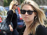 Pregnant Ali Larter shows off baby bump as she steps out in athletic attire
