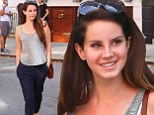 Comfy and casual: Lana Del Rey sported a loose grey shirt and baggy navy trousers as she left her apartment in New York City on Wednesday