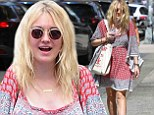 Bad hair day? Dakota Fanning gets a case of the frizzies during grunge-dressed outing in windy New York City