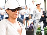 It's not-so-Scary Spice! Mel B carries smart trouser suit as she heads into her hotel in New York