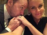 'Checking in from heaven': Jenny McCarthy and Donnie Wahlberg posed for their first newlywed selfie in a Twitter snap posted Tuesday