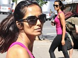 Padma Lakshmi heads out to the gym in bright, pink workout attire