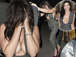 Daisy Lowe nearly spills out of her plunging jumpsuit as she leaves the GQ Men Of The Year Awards looking worse for wear