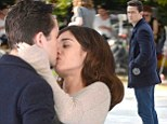 Hot and heavy! Joseph Gordon-Levitt and Lizzy Caplan steam up the camera as they share a passionate lip-lock on the set of their new movie
