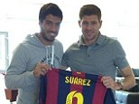 Friends reunited: Luis Suarez poses with Steven Gerrard (and a Barcelona shirt) at Melwood on Monday