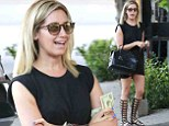 Gladiator girl: Ashley Tisdale showed off her legs in trendy knee-high sandals as she visited Nine Zero One salon in West Hollywood, California on Tuesday