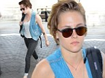 Kristen Stewart looks decidedly downcast as she arrives at LAX following reports of ex-boyfriend Robert Pattinson's hot new romance with singer FKA Twigs