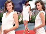 Looking good: Milla Jovovich looks lovely in her white dress as she attends the Cymbeline premiere at the Venice Film Festival on Wednesday - she has just announced she is expecting her second child