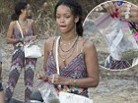 Rihanna stands out in multi-patterned jumpsuit as she carries plastic bag of suspicious looking substances during Mediterranean holiday