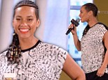 Blossoming: Alicia Keys showed just a hint of a baby bump as she attended the launch of Givenchy's new fragrance Dahlia Divin in New York City on Tuesday