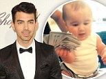 You're in the money baby! Joe Jonas posts video of toddler niece Alena waving around wad of hundred dollar bills