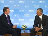 British Prime Minister David Cameron, left, and U.S. President Barack Obama, right, released a joint op-ed overnight declaring that their nations would 'not be cowed' by ISIS. The two world leaders met on Thursday prior to the NATO summit in Newport, Wales