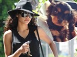 'She's just so cute!' Naya Rivera hits up the beauty salon in floppy hat and black jeans as she introduces new puppy
