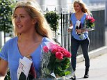 Singer Ellie Goulding was all smiles as she was spotted holding a dozen pink roses and a bottle of champagne out and about in London, UK. 03/092014..BYLINE MUST READ : JAMESY/GOTCHA IMAGES....Copyright by © Gotcha Images Ltd. All rights reserved...Usage of this image is conditional upon the acceptance ..of Gotcha Images Ltd, terms and conditions available at..www.gotchaimages.com