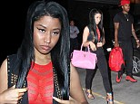 Putting on a (free) show: Nicki Minaj flashes her cleavage in sheer red top as she strolls through LAX with boyfriend Safaree Samuels