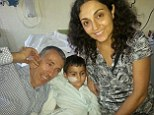 Reunited: Brett and Naghmeh King with Ashya in the Malaga hospital where he is currently being treated. Doctors have warned that he urgently needs chemotherapy for his brain turmour