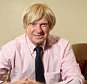 British Conservative Party politician Michael Fabricant in his Westminster office, London, England. Michael Fabricant was today ordered by No 10 to apologise for saying he might punch a female columnist ?in the throat?. Lichfield MP Michael Fabricant made the comments about Independent journalist Yasmin Alibhai-Brown after she appeared in a live TV debate. Mr Fabricant said on Twitter: ?I could never appear on a discussion prog with [her] I would either end up with a brain haemorrhage or by punching her in the throat.? He has since apologised.