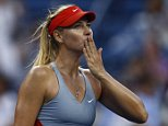 Maria Sharapova, of Russia, blows kisses to the crowd after defeating Alexandra Dulgheru, of Romania, during the second round of the 2014 U.S. Open tennis tournament, Wednesday, Aug. 27, 2014, in New York. (AP Photo/Matt Rourke)