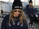 EXCLUSIVE casual but very fashionable Cara Delevingne leaving home reading from top to bottom is stay weird cara \n3 September 2014.\nPlease byline: Vantagenews.co.uk