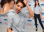 She's such a rebel! Katie Holmes gets a temporary neck tattoo at Old Navy bash for New York Fashion Week