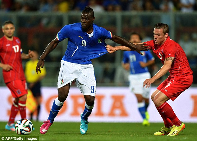 Hard to handle: Defenders have to stand up to the physical challenge with Balotellli