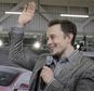 Tesla CEO Elon Musk waves during a rally at the Tesla factory in Fremont, Calif.