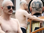 James Franco sports Elizabeth Taylor and Montgomery Clift tattoo on the back of his shaved head for new film role... as he displays a fuller physique during shirtless boat ride
