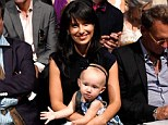 Floral baby: Hilaria Baldwin and her adorable daughter Carmen attend the Carmen Marc Valvo 25th anniversary show at Lincoln Center