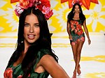 Adriana Lima dons floral headpiece and displays her toned legs in matching shorts while walking the runway at the Desigual fashion show