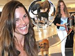 Oh the places they'll go! Hilary Swank takes her rescue dogs Kai and Rumi with her to Los Angeles airport
