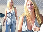Pulling a Kim Kardashian! Gwyneth Paltrow shows off her decolletage in revealing gray jumpsuit with plunging neckline