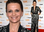 Her time to shine! Juliette Binoche glows on the red carpet of her new film despite co-stars Kristen Stewart and Chloe Moretz skipping the US premiere