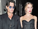 Best-dressed in black: Johnny Depp and his fiancée Amber Heard were a stunning pair in elegant black ensembles at Tuesday's GQ Men Of The Year Awards in London