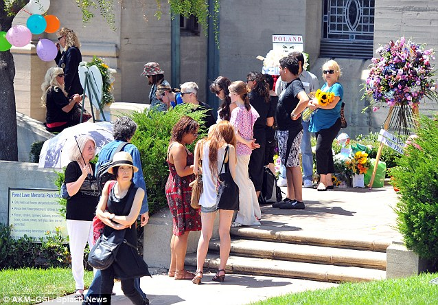 Paying their respects: These fans gathered at Michael's gravesite in Los Angeles